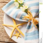 rustic-summer-table-setting-starfishes-blue-napkin-31365832